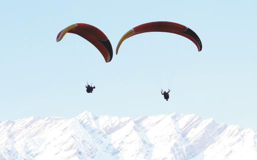 Tourists enjoying Paragliding at Solang Valley in Manali on Sunday. ANI Photo