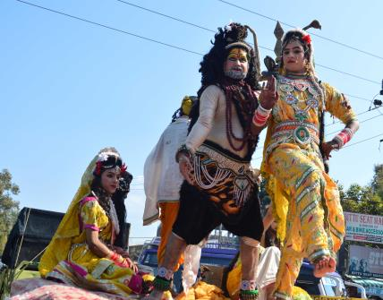 Devotees participate in a religious procession on eve of Maha Shivratri in Jammu.
