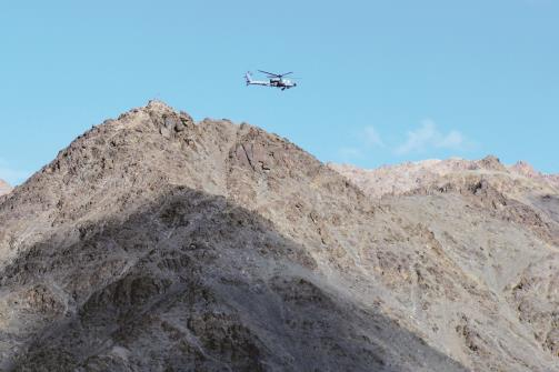 An Indian Air Force helicopter is seen flying against the backdrop of mountains surrounding Leh on Monday. ANI Photo