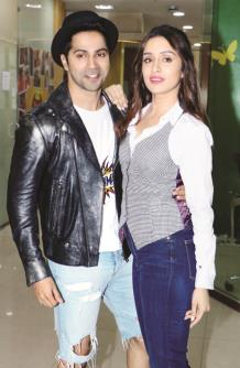 Bollywood actor Varun Dhawan and actress Shraddha Kapoor Pose for the Photographer during the promotion of their upcoming movie 'Street Dancer 3D'  at Radio Mirchi's office in Mumbai on Monday. (ANI PHOTO)