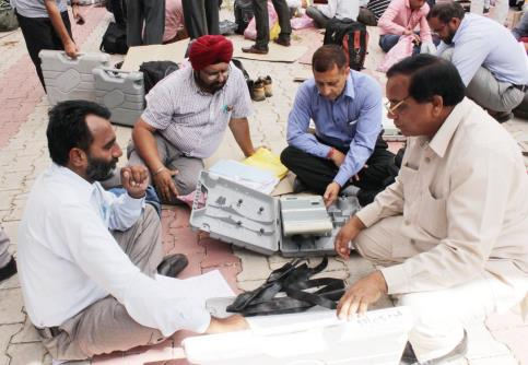 Polling officials checking the electronic voting machines (EVMs) in Jammu on Sunday on the eve of the first phase of ULB election.