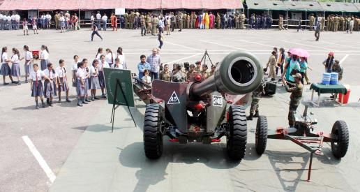 Students learn about weapons at an exhibition held by the Army in Jammu on Thursday.