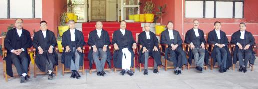 The outgoing Chief Justice, Justice Badar Durrez Ahmed posing for a photograph with the sitting judges of J&K High Court at Jammu.