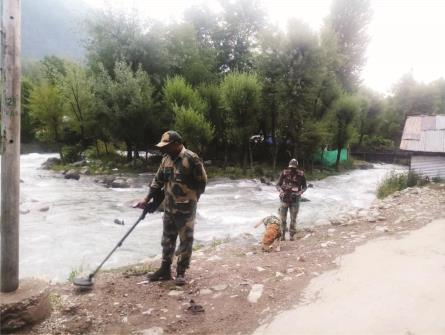 BSF Personnel use Sniffer dog and explosive detector during Amarnath Yatra at Chandanwari in Srinagar on Wednesday. (ANI Photo)
