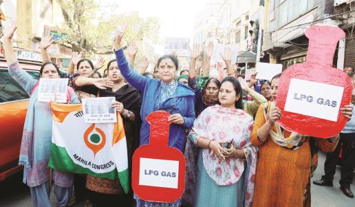 Members of Congress party hold placards & shout slogans during a protest against the price hike of LPG cylinders, in Jammu on Saturday. JL Baru