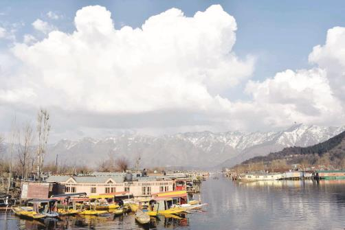 A splendid look of world famous Dal Lake during mellow sunshine in Srinagar on Friday.