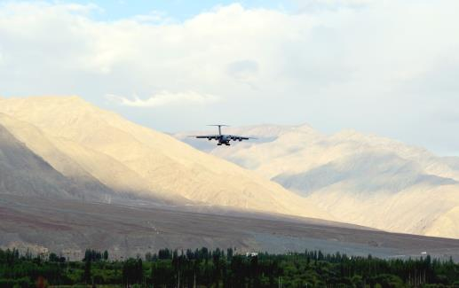 An Indian Air Force C17 aircraft is seen against the backdrop of mountains surrounding Leh on Friday.