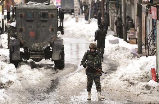 Security forces inspect the area as they conducted cordon and search operation (CASO) in Budgam on Friday. ANI Photo