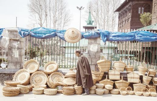 A Kashmiri wicker willow seller a waiting for the customers on the road side in Srinagar, on Saturday.