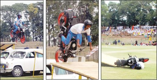 A daredevil of Jammu and Kashmir Police crashes his motorbike during full dress Independence Day rehearsal at Bakshi Stadium, Srinagar.