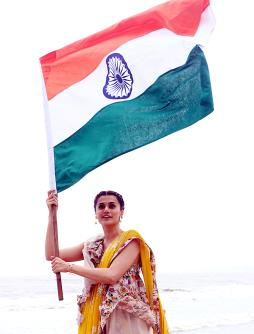 Bollywood actress Taapsee Pannu poses with Indian National Flag ahead of Independence Day in Mumbai on Tuesday. (ANI Photo)