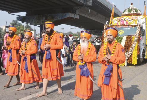 Panj Pyare clad in traditional dress leading the Nagar Kirtan in Jammu on Monday. JL Baru