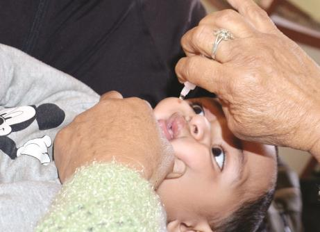 A health worker gives polio drops to a baby in Jammu on Sunday. JL Baru