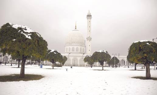 View of snow-covered Hazratbal shrine in Srinagar on Sunday. ANI Photo