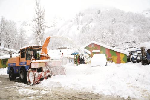 A snow cutter machine clears snow during a heavy snowfall in Jawahar tunnel on the Jammu-Srinagar National Highway on Monday. ANI