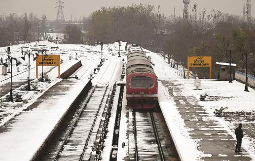 A train chugs on a snow-covered railway track as the train service got resumed in Kashmir after a gap of 99 days, in Srinagar. ANI photo