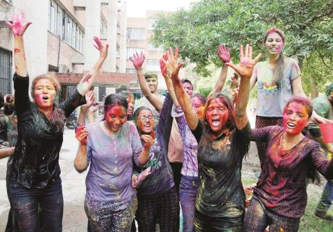 Students celebrating Holi with colours at Guru Nanak Dev University in Amritsar on Tuesday. @ANI
