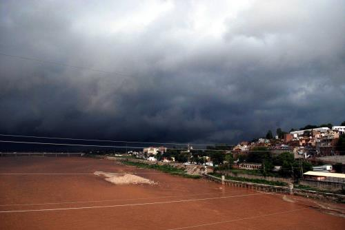 Dark clouds hover over Jammu city on Tuesday giving some respite to the people from heat.