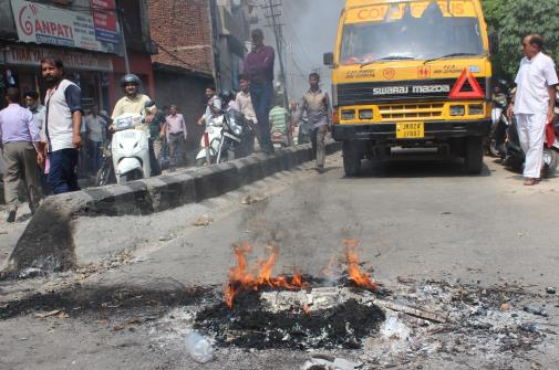 Demonstrators blocked Amphalla-Janipur road against erratic power and water supply on Thursday for more than three hours by burning tyres.