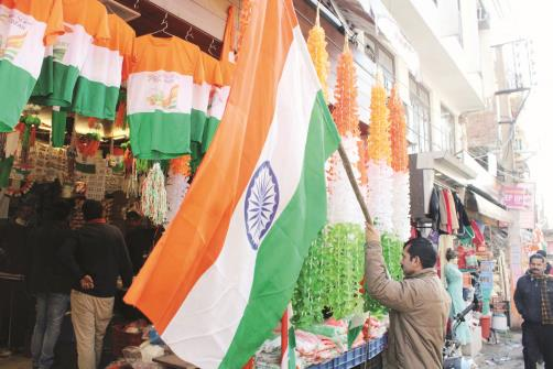 A person buys Indian National Flag ahead of Republic Day in Jammu on Wednesday. JL Baru