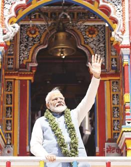 Prime Minister Narendra Modi waves from Badrinath temple at Badrinath on Sunday. (ANI Photo)