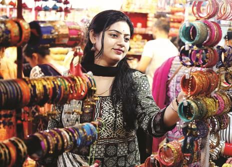 A woman looking at the bangles on the eve of Karva Chauth festival in Jammu on Tuesday.(ANI pic)