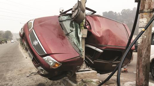 A car got stuck in a traffic signal pole after it met with an accident, near Narwal bypass in Jammu on Monday.