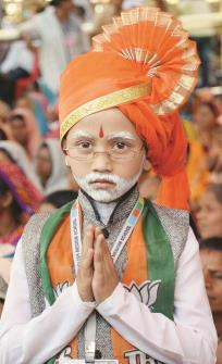 A BJP Supporter dress up like Prime Minister Narendra Modi as addresses public rally meeting for upcoming loksabha elections 2019 in Nandurbar on Monday. (ANI)