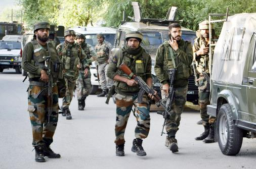 Army jawans cordon off the area after two BSF jawans succumbed to injuries by terrorists as they attacked Border Security Force (BSF) at Pandach Chowk in Srinagar on Wednesday.