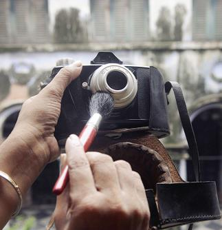 A lady cleaning a Rare Vintage India Made AGFA Click III 120 mm Point and Shoot Camera in the eve of World Photography day in Kolkata  on Sunday. (ANI Photo)