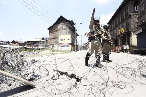 Security forces jawans guard a street during restrictions in downtown Srinagar.