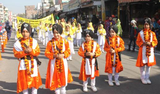 Sikh children participate in a religious procession ahead of the birth anniversary of Guru Nanak in Jammu.